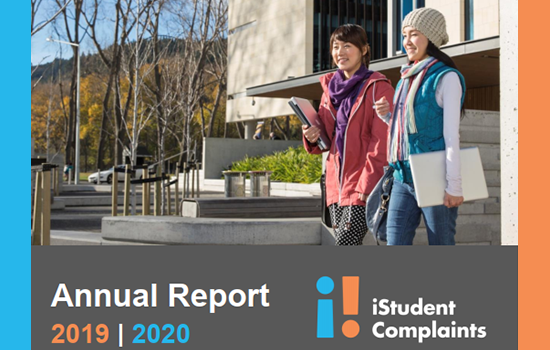 Annual Report Title, two international students in front of University